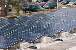 An image of an array of roof-top photovoltaic panels on Massasoit's Brockton Campus